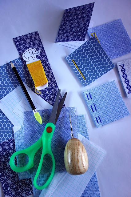 scissors, thread, pencil, awl, paper, craft materials, security envelopes, sewing, bookbinding