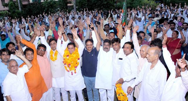 Rajesh Nagar receives BJP leader Ashoka Ankeley