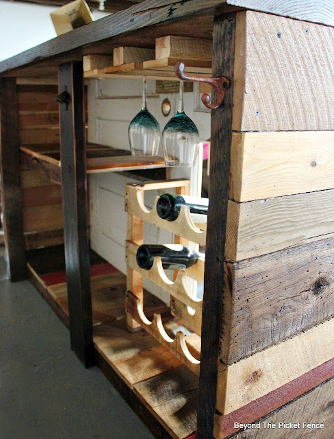 wine holder, pallet wood, wineglass holder, DIY, bar, http://bec4-beyondthepicketfence.blogspot.com/2016/03/rustic-old-door-bar-diy.html