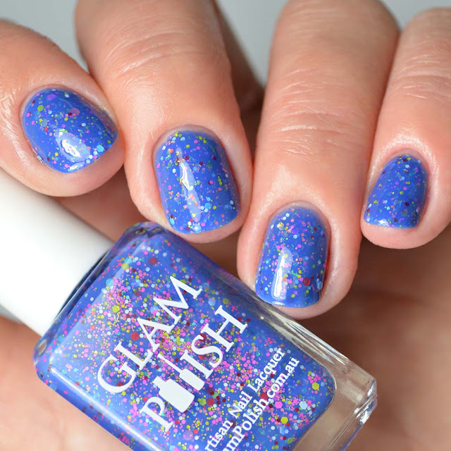 blue nail polish with glitter four finger swatch