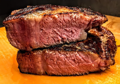 Stack of Beef Steaks Cut Think and Grilled Rare