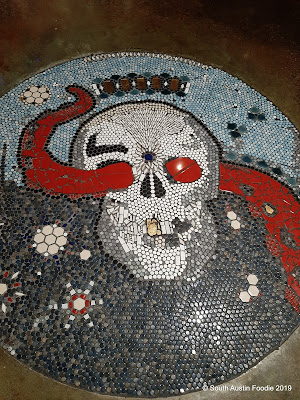 The Shore mosaic skull entryway