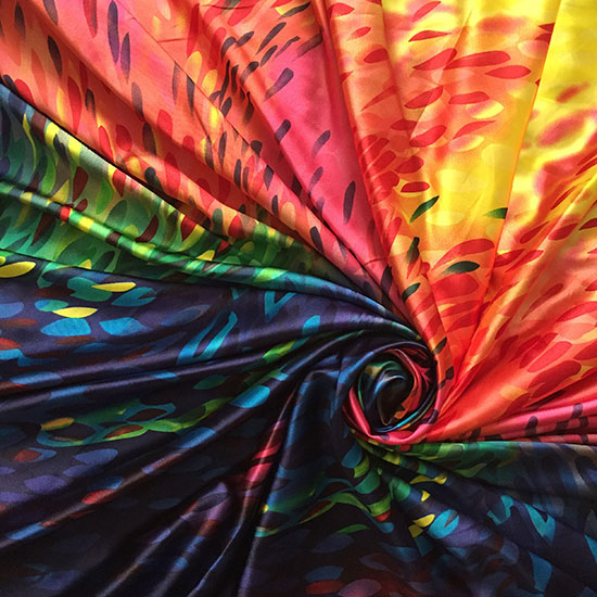 Colorful fabric arranged in a swirl.