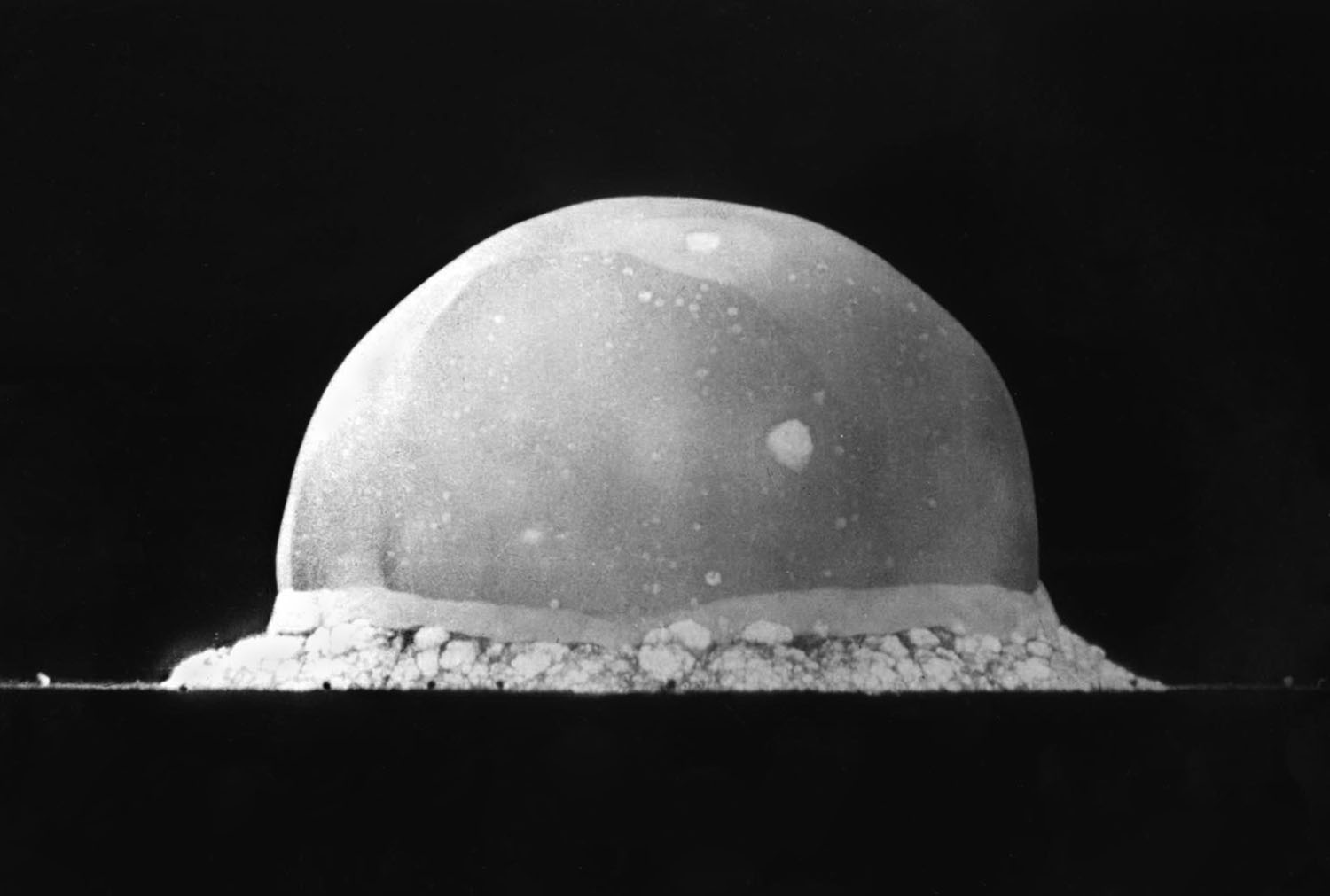 The Trinity explosion, 16 ms after detonation. The viewed hemisphere's highest point in this image is about 200 metres (660 ft) high.