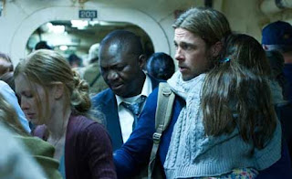 Brad Pitt, Mireille Enos and Fana Mokoena in World War Z