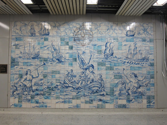 Ceramic tilework by Ana Vilela, installed in late 2003 in the Queen's Park mezzanine. The piece commemorates the 50th Anniversary of Portuguese Emigration to Canada.