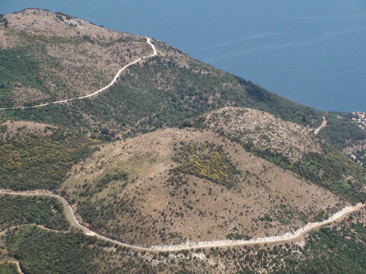 View to the island of Corfu from the monastery on Mount Pantocrator. Вид на остров Корфу из монастыря на горе Пантократор.