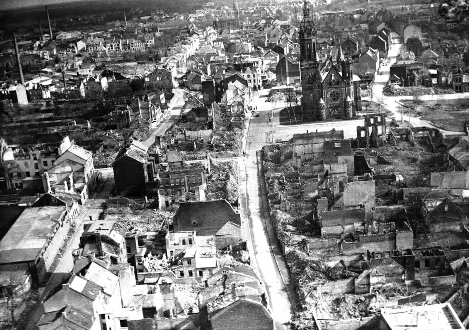 In Europe, some churches have been completely ruined, but others still stand amid utter devastation. Munchengladbach Cathedral stands here in the rubble, though still in need of repairs, seen in Germany, on November 20, 1945.