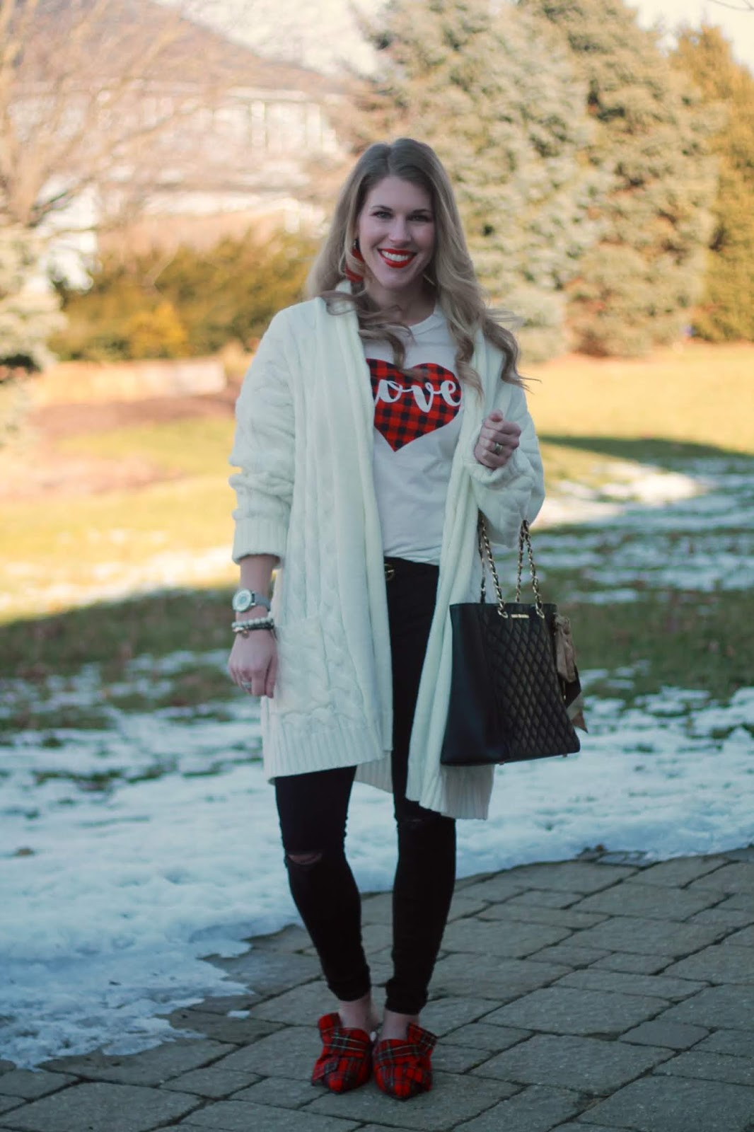 buffalo plaid heart tee, white cable knit cardigan, black distressed jeans, starking watch, red plaid bow mules, black quilted tote