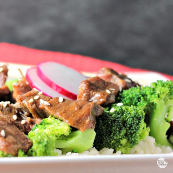 Slow Cooker Beef and Broccoli | by Renee's Kitchen Adventures sitting on white plate close up