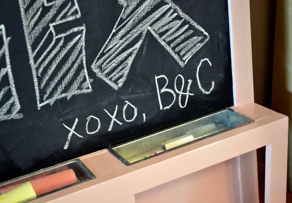 We are so happy with our first kid-friendly DIY project! See how we took an old dirty chalkboard and made it perfectly pink and new again!