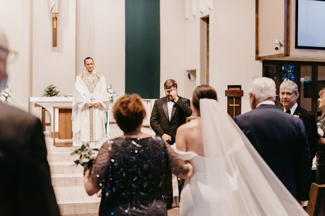 bride walking down aisle at st margaret mary