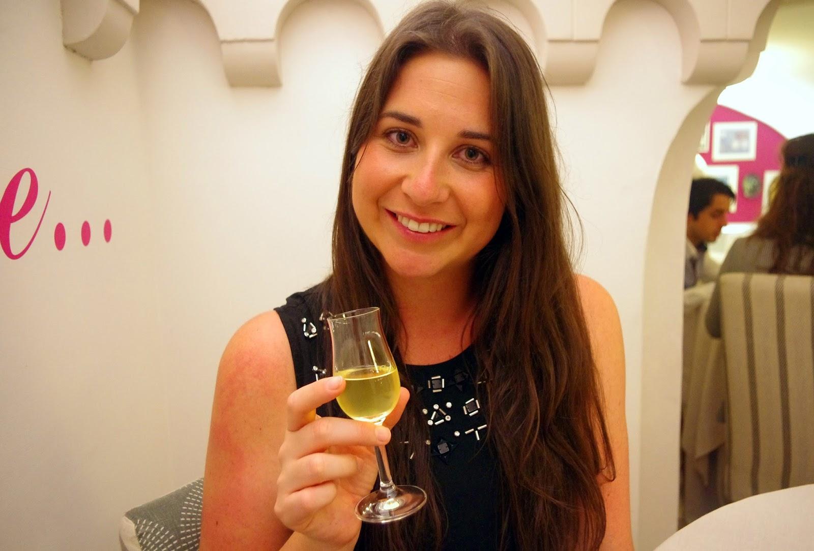 Girl drinking Limoncello in Il Buco Restaurant Sorrento Italy