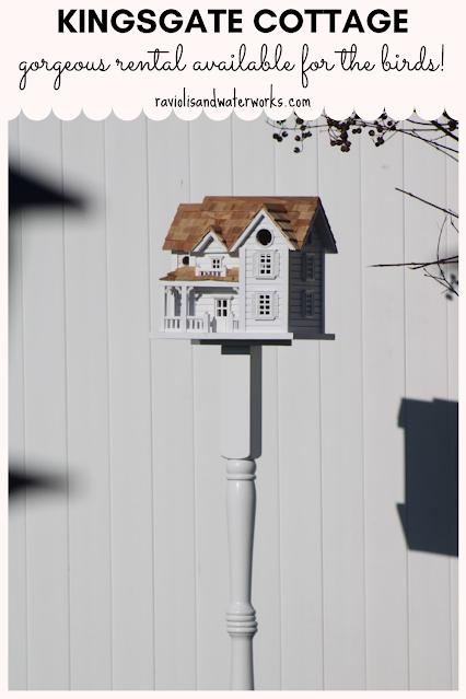 birdhouse on a pole that looks like a real house