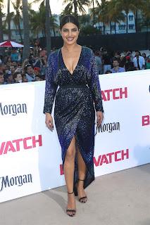 Gorgeous boobs of Priyanka CHopra in bra less leg split gown for Baywatch Premiere