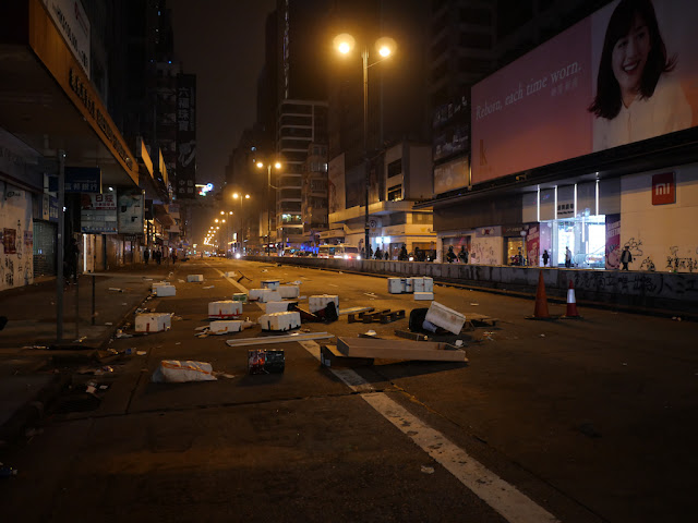 debris set by protestors to block Nathan Road