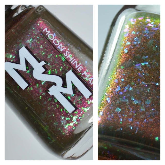 navy nail polish with shimmer and glitter in a bottle