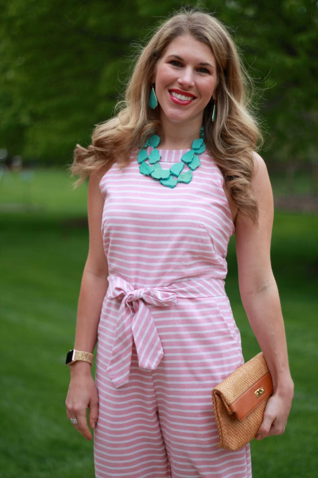 pink striped jumpsuit, turquoise jewelry, straw clutch, nude pumps