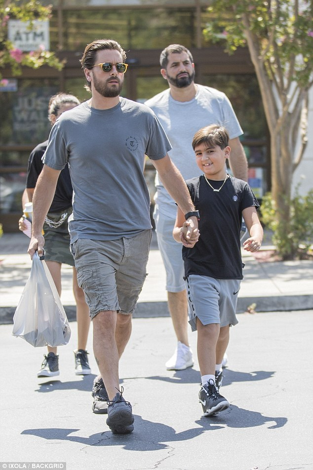 Scott Disick and son Mason wears matching outfits as they hold hands while out in LA