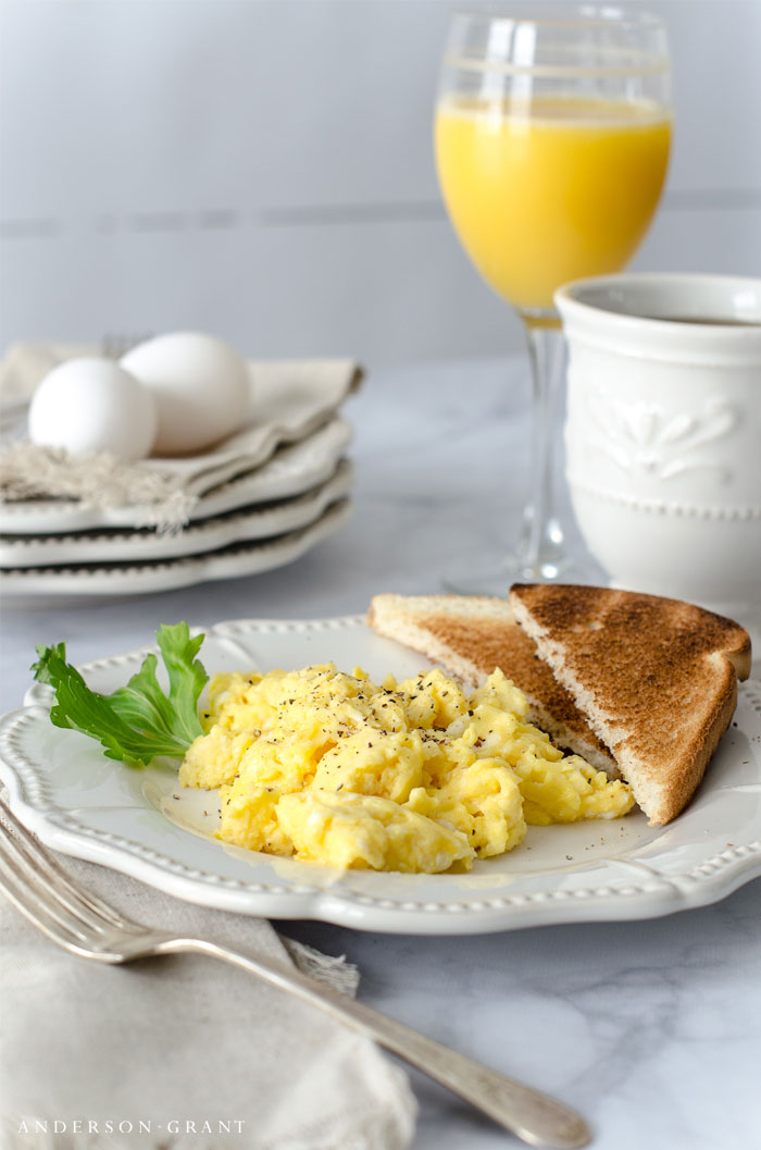 Find out what secret ingredient you should be adding to make scrambled eggs the best you've ever tasted. #recipes #breakfastrecipes #breakfast #andersonandgrant