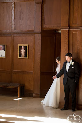 bride and groom doing first touch with door