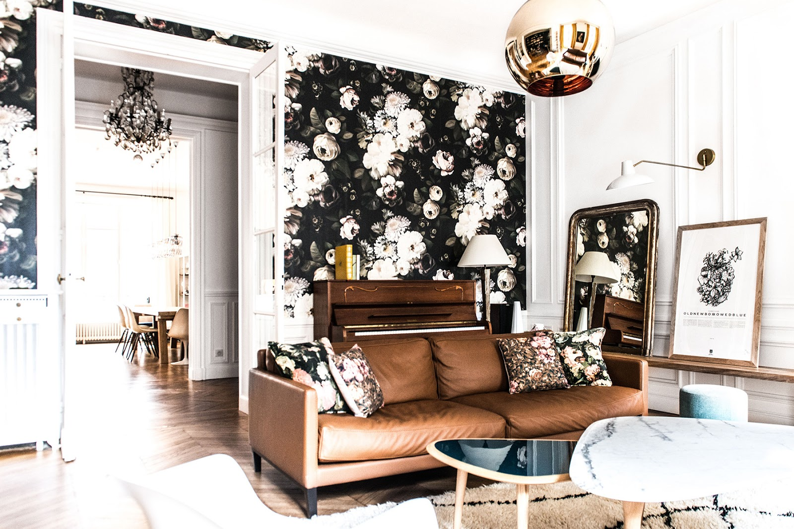 bohemian and chic paris apartment with parquet floors, eames and saarinen chairs, tom dixon lamps and wallpapers