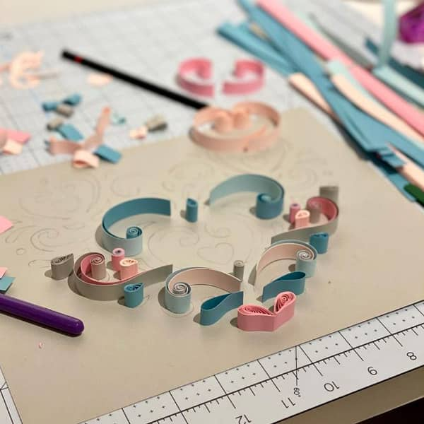 precise quilled heart design in progress