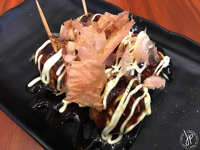 takoyaki with mayonnaise, sauce and bonito flakes