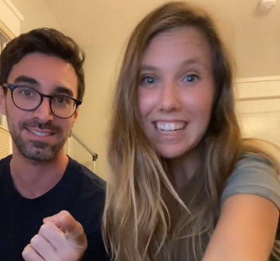 Smiling Jesse and Suzie in a room for a TikTok video