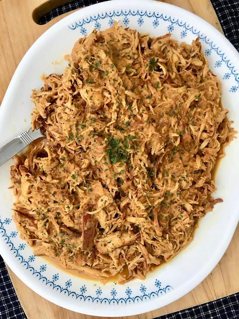 Platter filled with shredded honey mustard chicken.