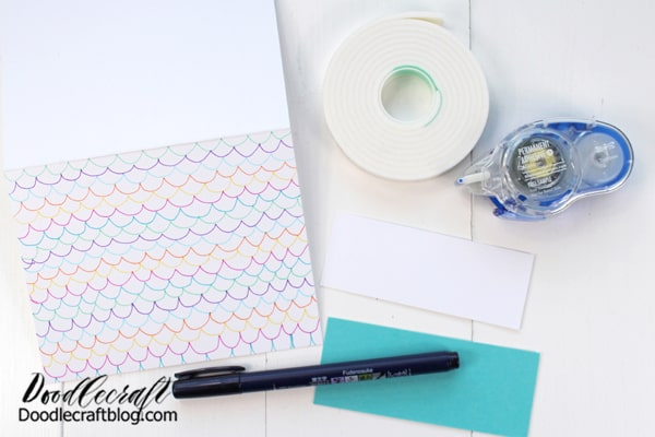 Lastly, this option is my favorite. Cut a piece of colored paper 1/4 inch larger than a piece of white cardstock. Hand letter a sentiment on the white cardstock. Use the MONO Permanent Adhesive to adhere the white cardstock to the colored paper, leaving a small border around the edge.