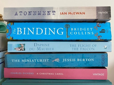 Five paperback books from the charity shop