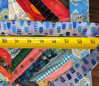 Measure the binding and insert a pin at the appropriate length for each side of the quilt