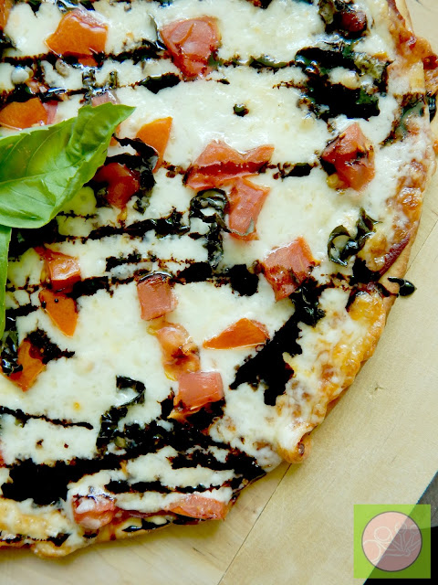 margarita pizza with balsamic drizzle (sweetandsavoryfood.com)