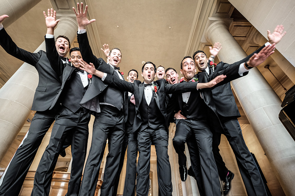 groom and groomsmen in San Francisco City Hall lobby