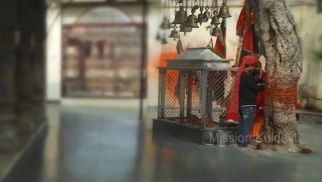 Couple worshiping inJamwai Mata Temple Jamwa Ramgarh Jaipur