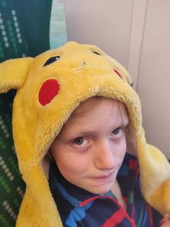 boy in PIkachu hat
