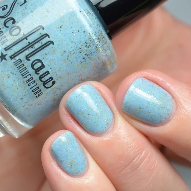light blue creme with gold flecks swatch