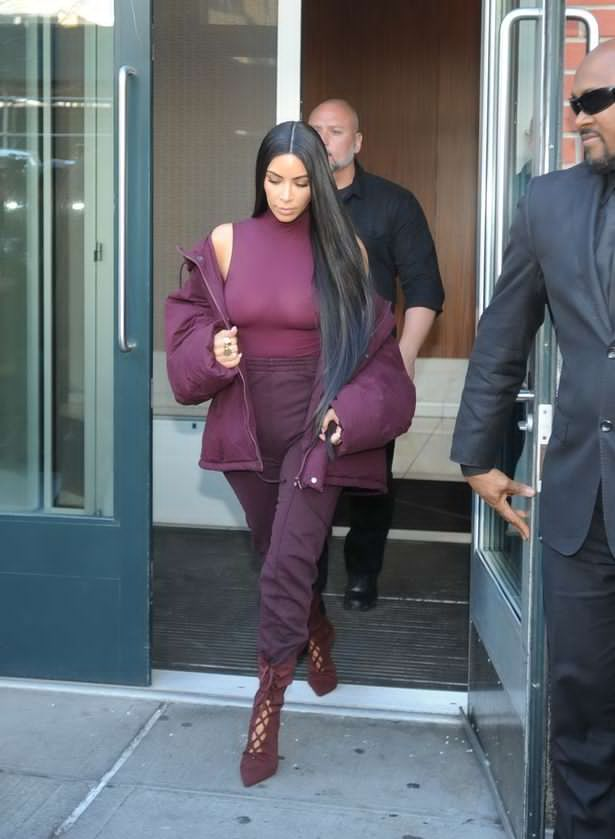 Controversial Kim Kardashian flashes boobs in sheer purple top while heading to Kanye West's Yeezy show