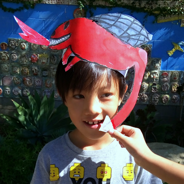 diy dragon hat made from cut out paper and paint