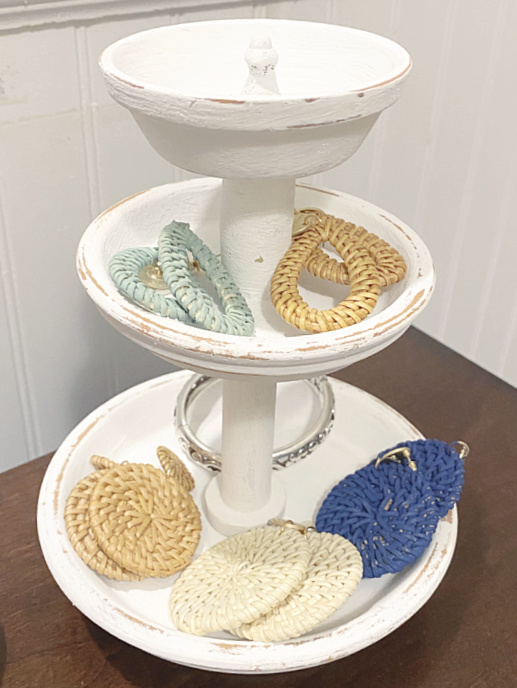 tiered tray filled with earrings