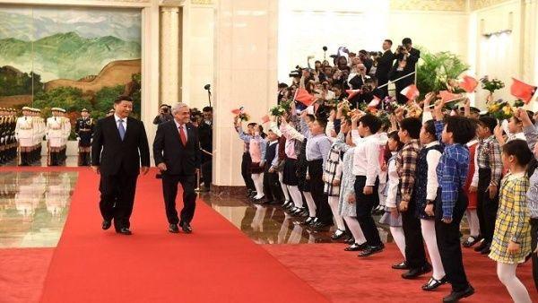China y Chile firman convenios de inversión comercial
