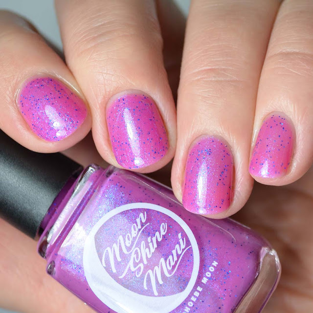 purple shimmer nail polish close up swatch