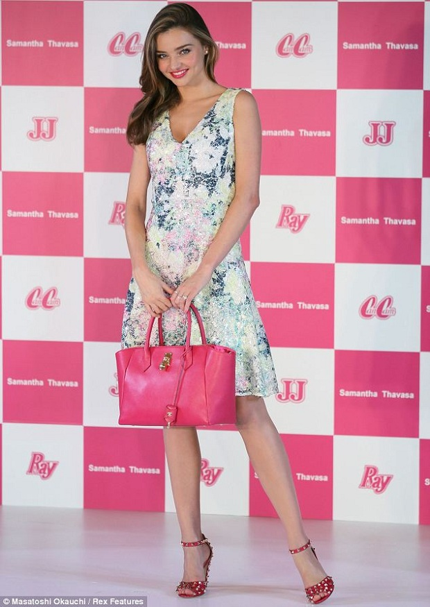 Miranda Kerr in a floral Erdem dress and pink studded Valentino sandals