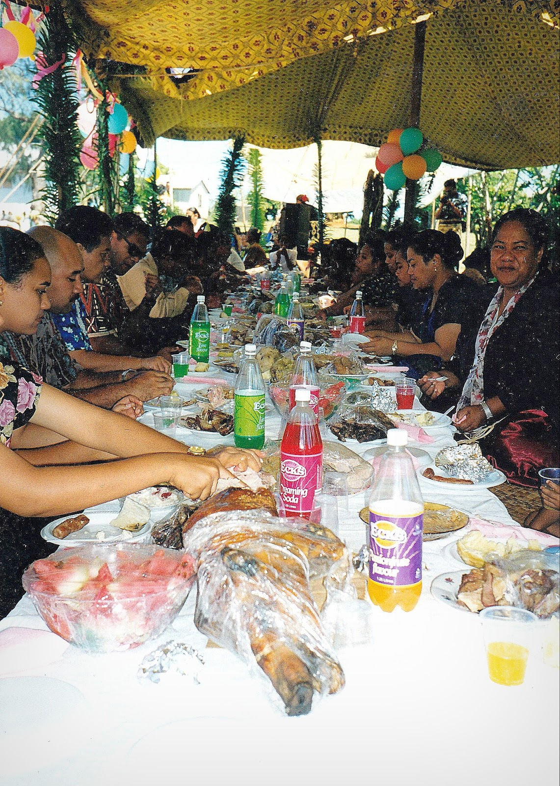 Tongan feast includes an array of fresh fruit, fish and meats.