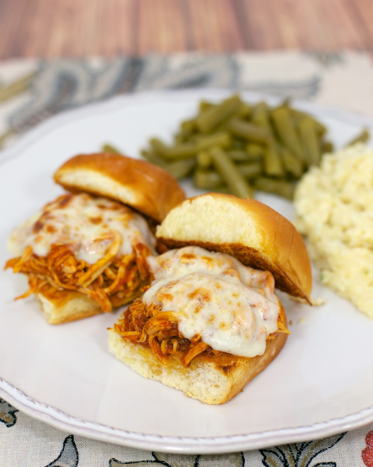 Slow Cooker Chicken Parmesan Sliders - only 3 ingredients for the chicken! Chicken, spaghetti sauce, garlic, mozzarella cheese and buns. Great for an easy weeknight meal or tailgating. Everyone cleaned their plate!!