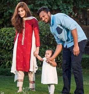 Shakib with his wife and baby