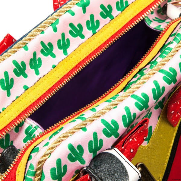 close up of open zip on handbag in yellow and red with cactus printed fabric