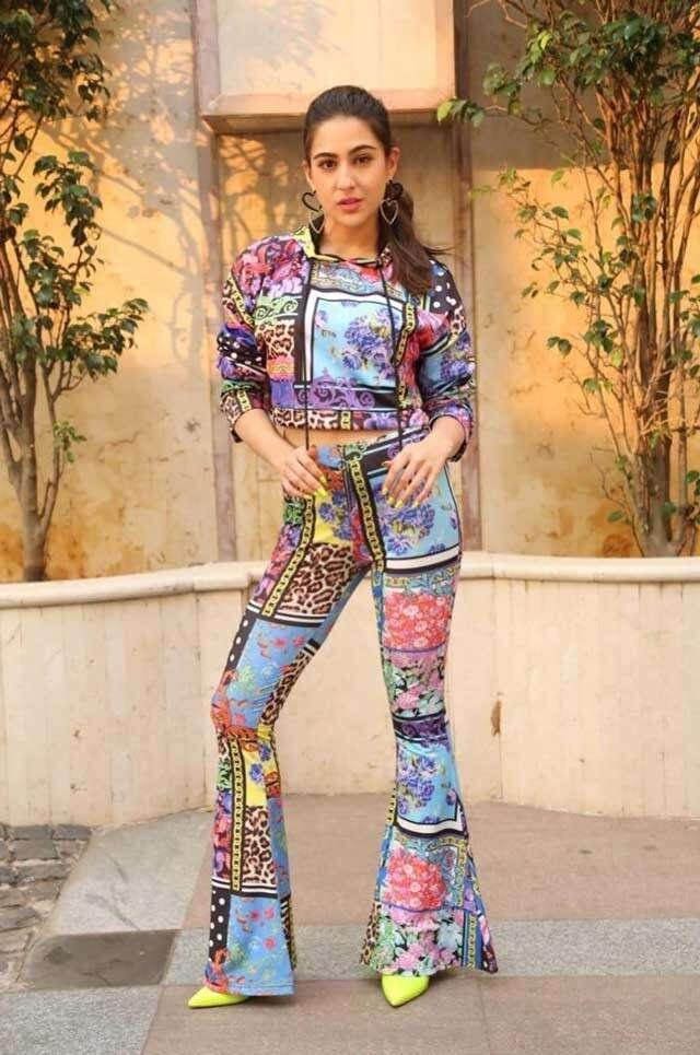 woman in printed jumpsuit