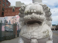 Lion Statue staring aggressively at the Camera